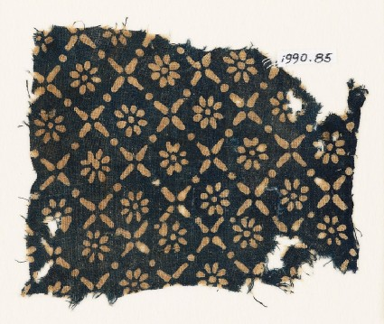 Textile fragment with flowers, dots, and rosettesfront