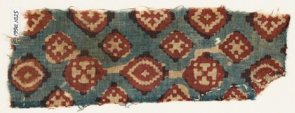 Textile fragment probably imitating patola pattern, with diamond-shapes and crossesfront