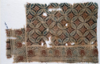 Textile fragment with linked circles and rosettesfront