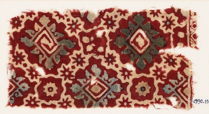 Textile fragment with ornate squares, stars, and flowersfront