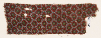 Textile fragment with grid of oval shapes and rosettesfront