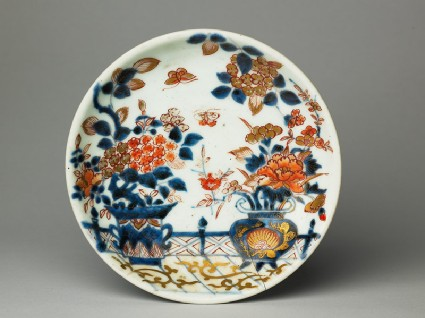 Saucer with flowers on a terracetop