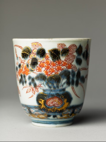 Cup with flowers on a terraceside