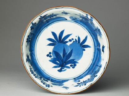 Foliated bowl with flowers and birdstop