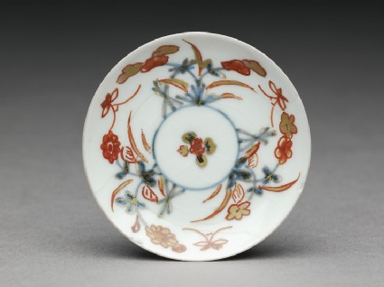 Miniature saucer with flowers and butterfliestop