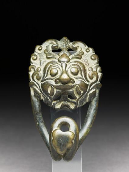Bronze belt clasp with demon facefront