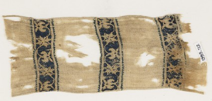 Textile from a scarf or girdle with scrolling tendrils and flowersfront