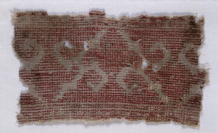 Textile fragment with tendrilsdetail, reverse, front