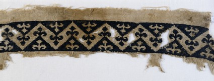 Textile fragment with band of chevrons and trefoil finialsfront