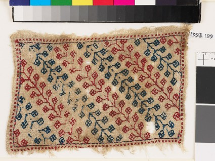 Textile fragment with stems and pairs of stylized leavesfront
