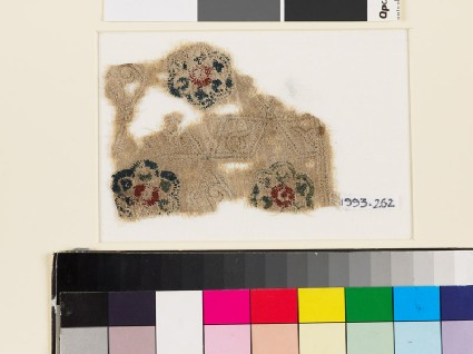 Textile fragment with lobed rosettes, rhomboids, and tendrilsfront