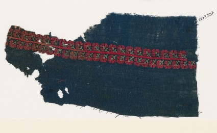 Textile fragment from a garment with band of stylized flowersfront
