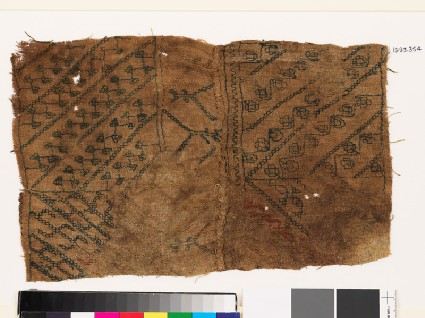 Sampler with diagonal lines, hooks, and stylized flower-headsfront