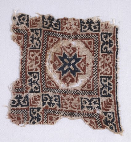 Textile fragment with star and pseudo-inscriptionfront