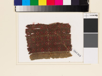 Textile fragment with large and small diamond-shapesfront