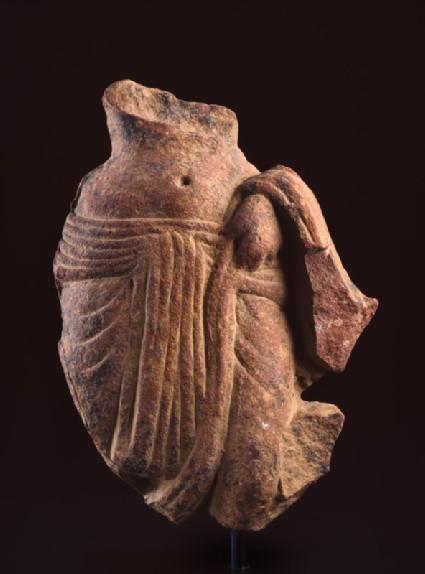 Fragment of a female figurefront