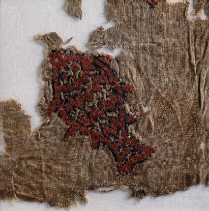 Textile fragment with fishdetail, front