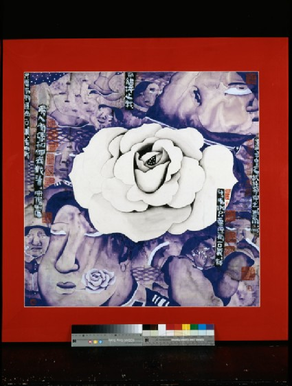 White flower surrounded by facesfront