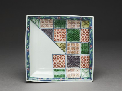 Plate with geometric decoration in the style of textile patternstop