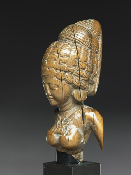 Female figure with a tall headressside