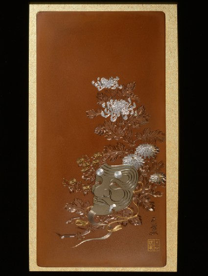Panel with a mask of Okina lying on flowersfront