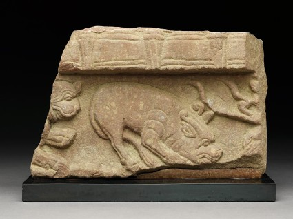 Fragment of a coping stone with horned mythical creaturefront