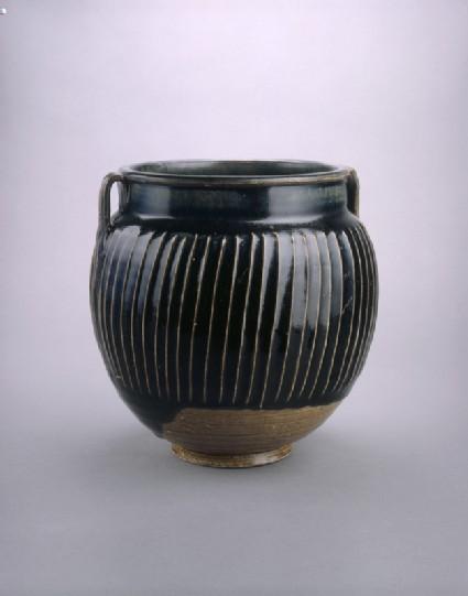 Black ware jar with white stripesside