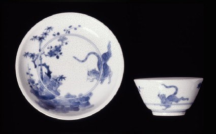 Saucer with leaping tigertop
