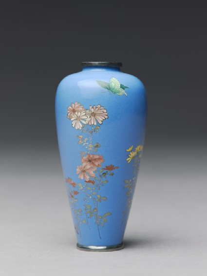 Vase with chrysanthemums and a butterflyside