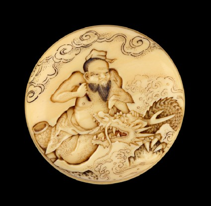 Manjū netsuke depicting the Daoist immortal Bashikō performing acupuncture on a dragonfront