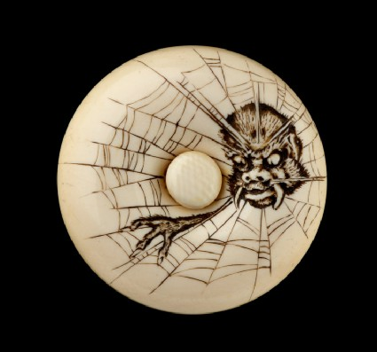 Manjū netsuke depicting the Earth Spider in a webfront