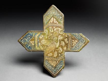 Cross tile with birdtop