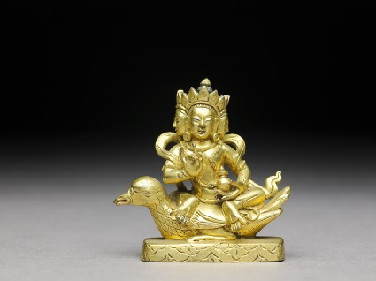 Figure of a bodhisattva seated on a birdfront