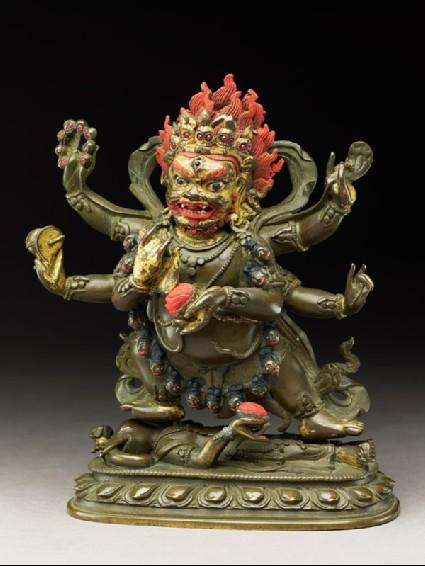 Figure of a male deity with six arms standing on an elephant-headed figureside