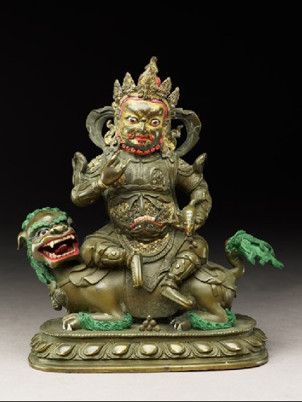 Figure of a male deity seated on a mythical animal, possibly a lion dogfront