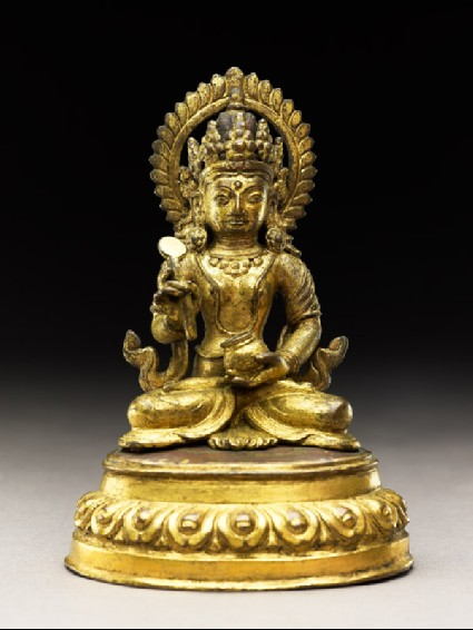 Seated figure of a deity holding a spoon and potfront