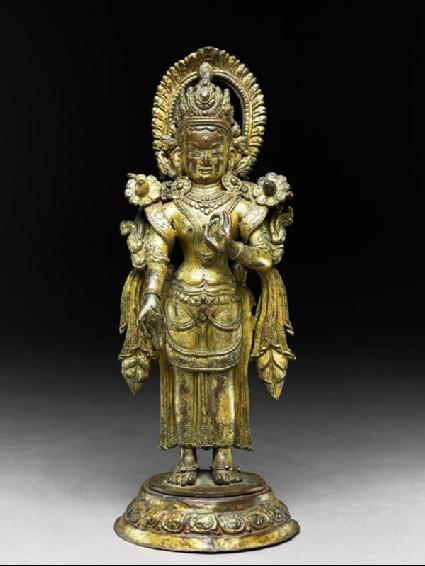 Standing figure of a female deityfront