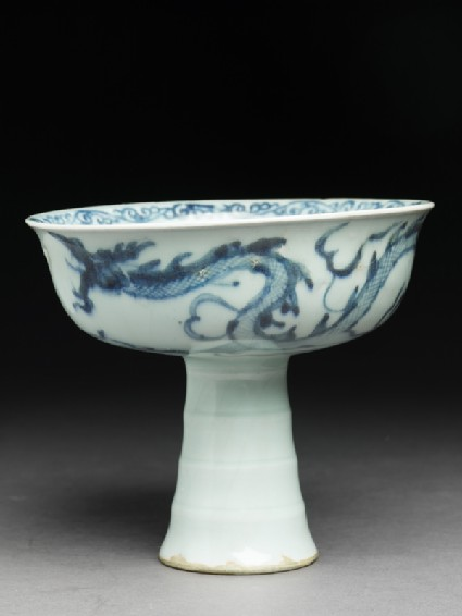 Blue-and-white stem cup with a dragon and cloudsside