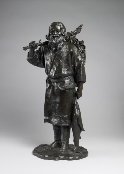 Figure of an Ainu fisherman with his catchfront