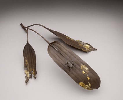 Okimono, or ornament, in the form of bamboo leaves and a cicadaoblique