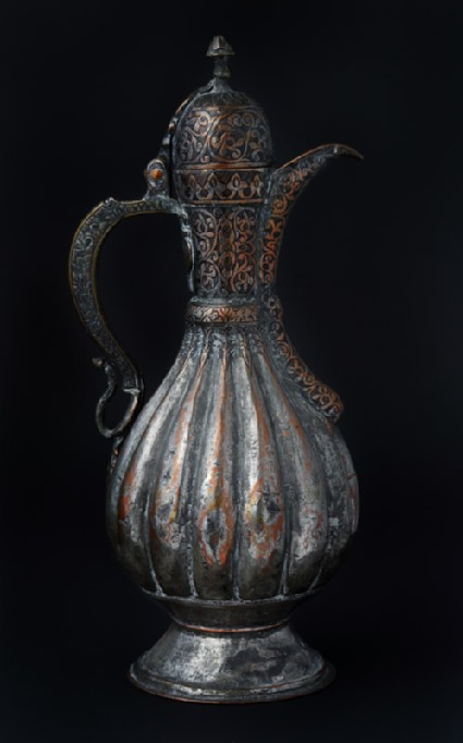 Ewer with scalloped body and engraved decorationfront