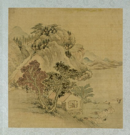 Landscape with a figure standing in a housefront