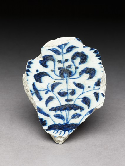 Base fragment with floral decoration in blue on whitefront