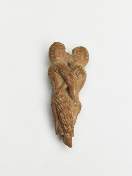 Terracotta figure of monkeys embracingoblique