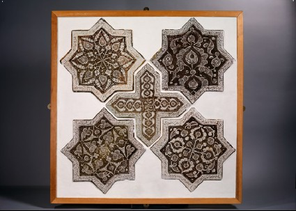 Set of five tiles in the shapes of stars and a crossfront