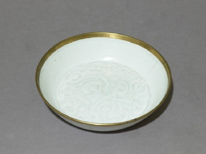 White ware dish with floral decorationoblique