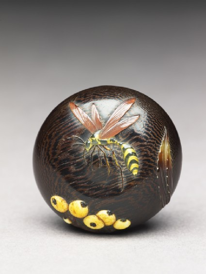 Manjū netsuke with wasp and berriesfront