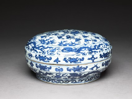Blue-and-white box with figures in a gardenoblique