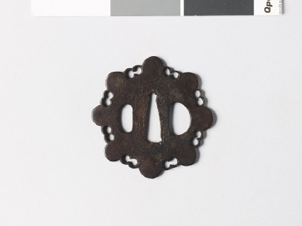 Tsuba in the form of a stylized flowerfront