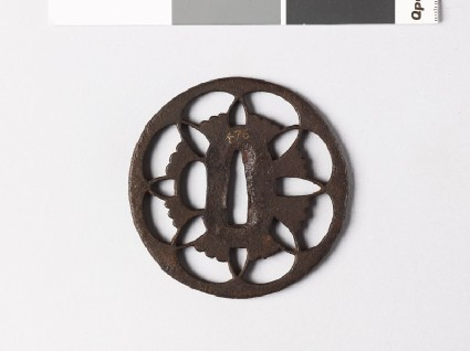 Tsuba with floral device of overlapping petalsfront